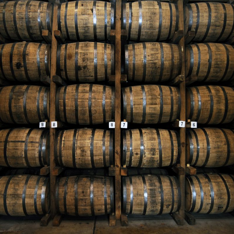 Stack of Wooden Whiskey Barrels